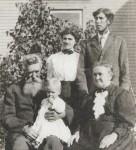 Henry B., holding Glenn, Sarah (Milligan) Bennett, Lura (Monroe) & Vermont Bennett standing, c1913
