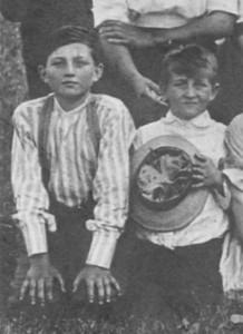 Mainard Brewster, holding hat, first Brewster reunion, 1913.
