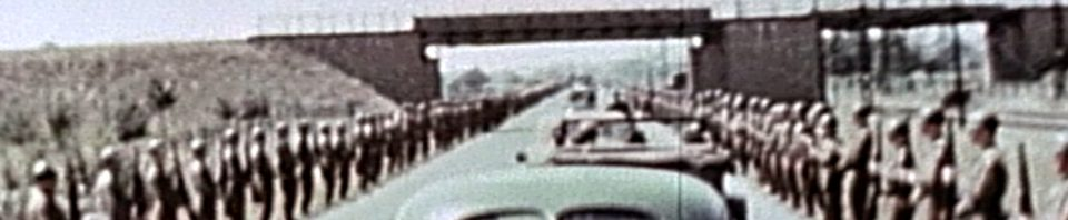 President Truman drives by troops, Frankfurt, Germany, 26 July 1945. Herbert Miller standing along the road. Photo used with license, Critical Past.